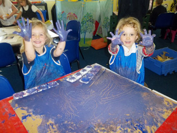 Kids Club children at messy play